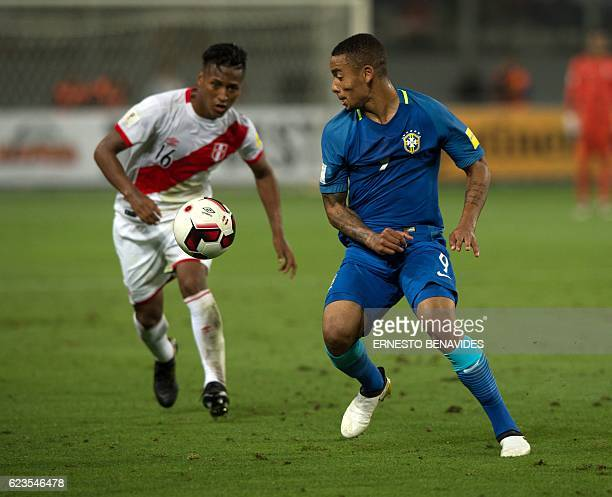 Peru's Pedro Aquino and Brazil's Gabriel Jesus eye the ball during their 2018 FIFA World Cup qualifier football match in Lima on November 15 2016 /...