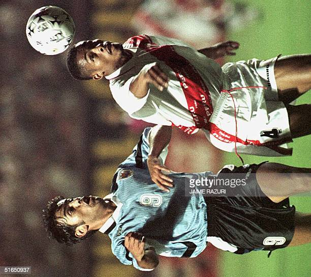 Peru's Percy Olivares keeps the ball from Uruguay's Ruben Fonseca 10 September during their qualification game for the France 98 World Cup in Lima...