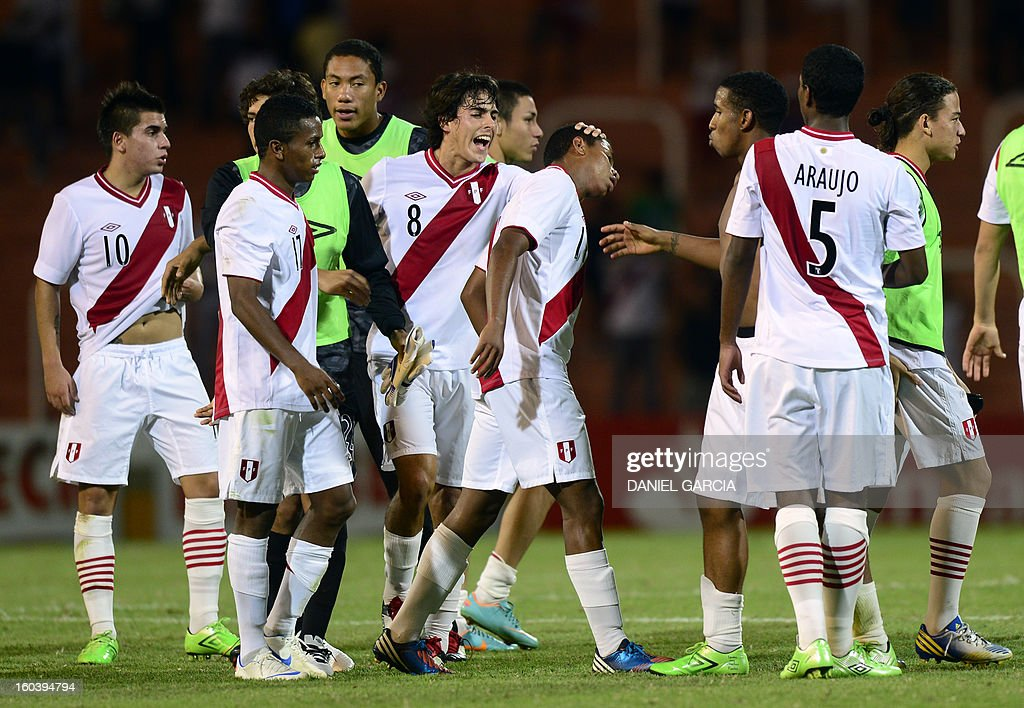 Peru's players celebrate at the end of their South American U-20 final round football match against Ecuador at Malvinas Argentinas stadium in Mendoza, Argentina, on January 30, 2013. Four teams will qualify for the FIFA U-20 World Cup Turkey 2013.