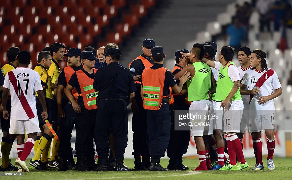 Peru's players complain with the referees at the end of their South American U-20 final round football match against Chile at Malvinas Argentinas stadium in Mendoza, Argentina, on February 3, 2013. Four teams will qualify for the FIFA U-20 World Cup Turkey 2013.