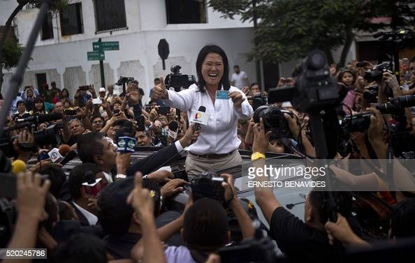 Peru´s presidential candidate Keiko Fujimori waves upon arrival at the voting station during general elections in Lima on April 10 2016 Almost 23...
