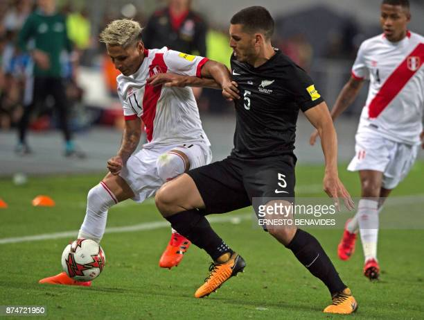 Peru's Raul Ruidiaz and New Zealand's Michael Boxall vie for the ball during their 2018 World Cup qualifying playoff second leg football match in...