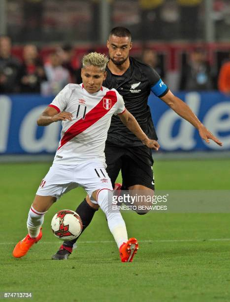 Peru's Raul Ruidiaz and New Zealand's Winston Reid vie for the ball during their 2018 World Cup qualifying playoff second leg football match in Lima...