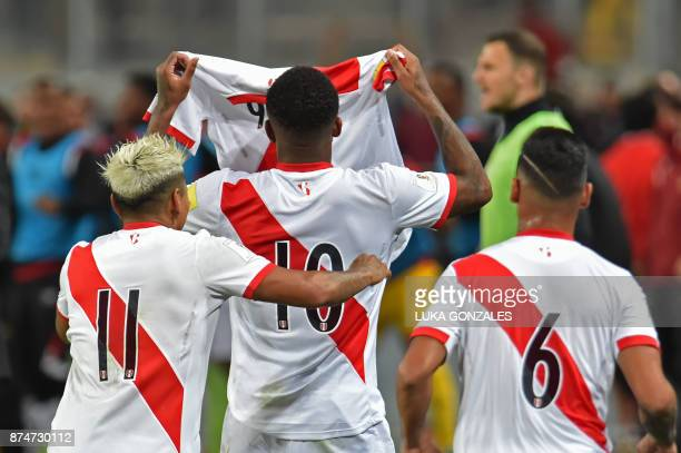 Peru's Raul Ruidiaz Jefferson Farfan and Miguel Trauco show a number nine jersey in support of their suspended teammate Paolo Guerrero during their...
