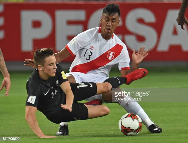 Peru's Renato Tapia struggles for the ball with New Zealand's Ryan Thomas during their 2018 World Cup qualifying playoff second leg football match in...