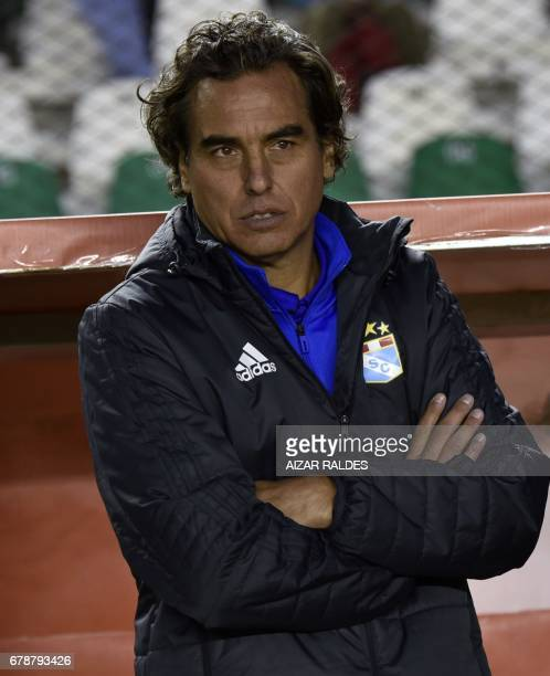 Peru's Sporting Cristal coach Jose Guillermo Del Solar gestures during their Copa Libertadores match against Bolivia's The Strongest at Hernando...