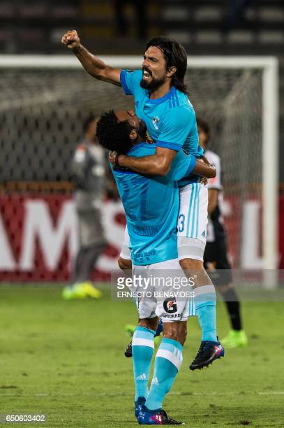 Peru's Sporting Cristal Jorge Luis Cazulo celebrates after scooring against Brazil's Santos during their Libertadores Cup football match at the...