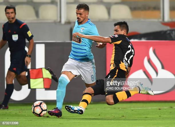 Peru's Sporting Cristal player Gabriel Costa vies for the ball with Bolivias The Strongest player Juan Valverde during their Copa Libertadores match...