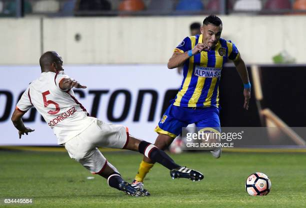 Peru's Universitario Alberto Rodriguez and Paraguays Deportivo Capiata player Roberto Gamarra vie for the ball during their second encounter in the...