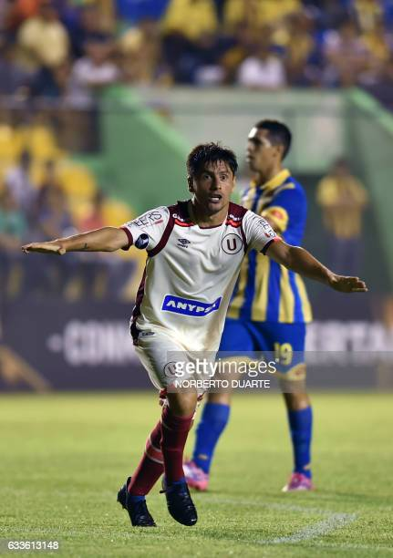 Peru's Universitario player Diego Manicero celebrates after scoring against Paraguay's Deportivo Capiata during their 2017 Copa Libertadores match at...