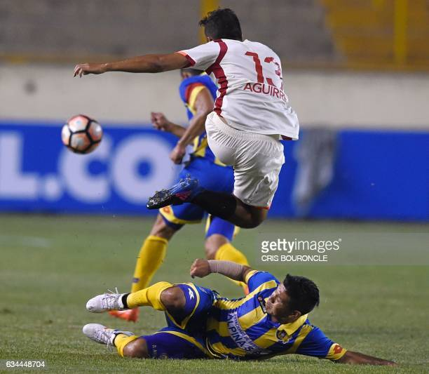 Perus Universitario player Joaquin Aguirre and Paraguays Deportivo Capiata player David Mendieta vie for the ball in the firstround Copa Libertadores...