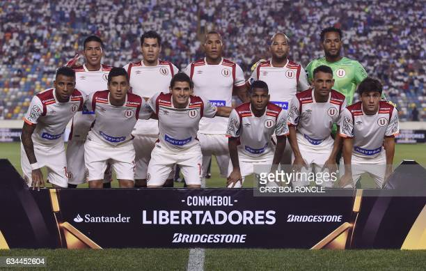 Perus Universitario players pose for photographers before their Copa Libertadores football match against Paraguay's Deportivo Capiata at the...