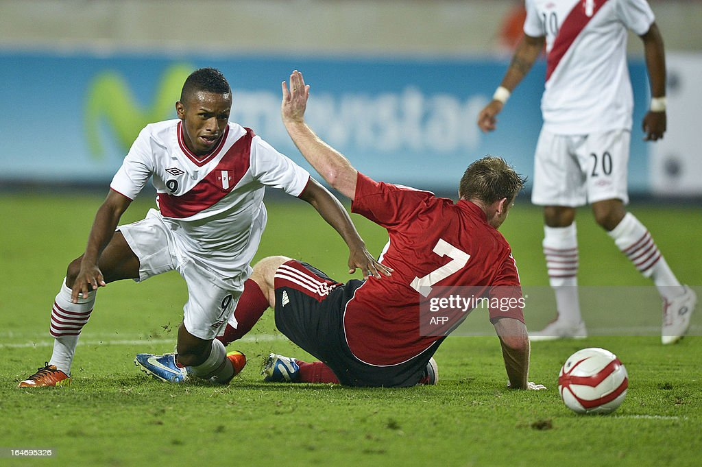 Peru's Yordy Reyna (L) vies for the ball with Birchall Christopher (R) of Trinidad & Tobago during a friendly match at at the National stadium in Lima on March 26, 2013.