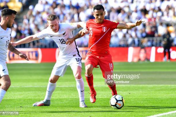 Peru's Yoshimar Yotun fights for possession with New Zealand's Kip Colvey during the World Cup football qualifying match between New Zealand and Peru...