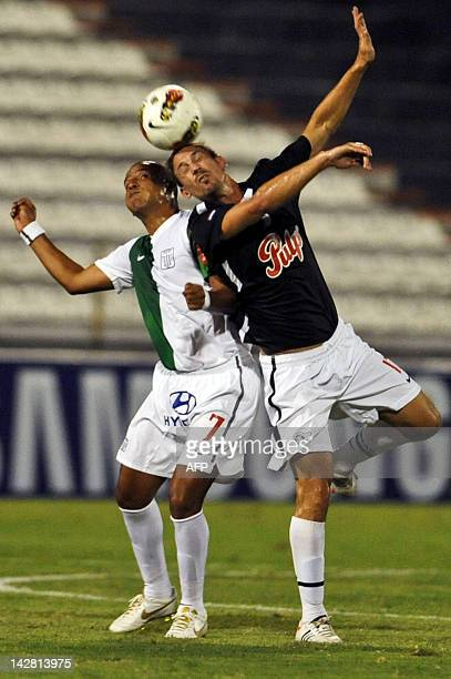 Peruvian Alianza Lima's Edgar Gonzalez vies for the ball with Sergio Aquino from Paraguayan Libertad during their Copa Libertadores 2012 football...