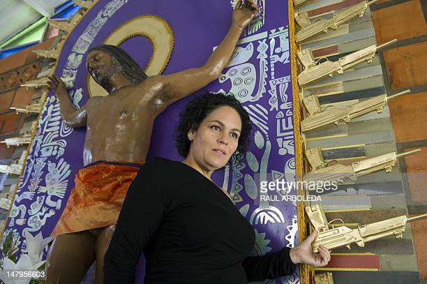 Peruvian artist Cristina Planas Toledo poses next to her work Cristo Moreno during the opening of the first mausoleum for victims of violence in...