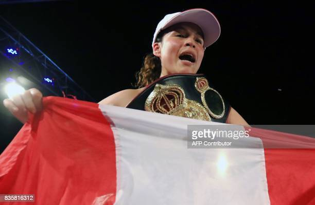 Peruvian boxer Linda Lecca celebrates after defending her World Boxing Association Super Flyweight crown for the fourth time by defeating Mexican...