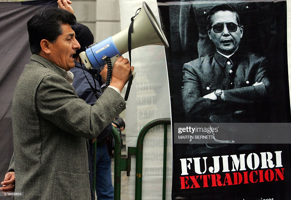 A Peruvian citizen resident in Chile shouts slogans against the release last week of former Peruvian President Alberto Fujimori in front of the Court...