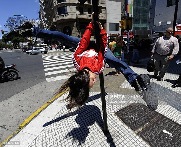 A Peruvian competitor of the Miss Pole Dance Sudamerica 2010 performs in front of the Obelisk in downtown Buenos Aires on November 5 on the eve of...