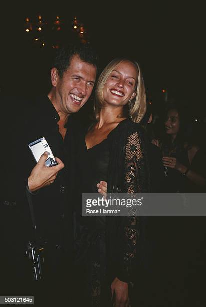 Peruvian fashion photographer Mario Testino and American actress and model Amber Valletta attend an event at Cipriani New York City 1992