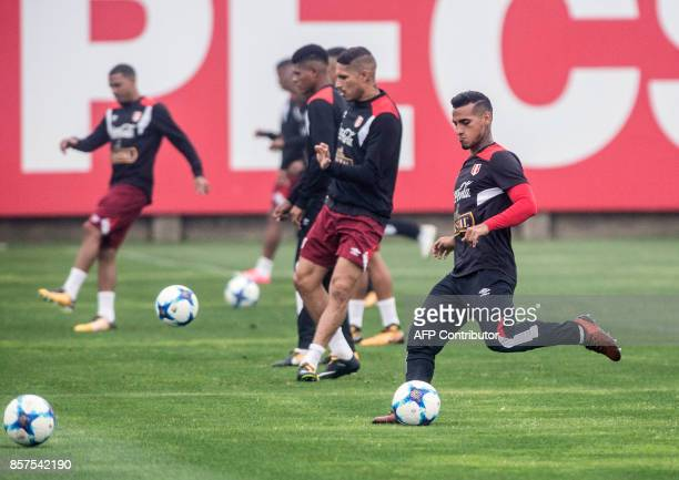 Peruvian footballer Miguel Trauco kicks the ball during a training session in Lima on October 4 2017 ahead of their upcoming 2018 FIFA World Cup...