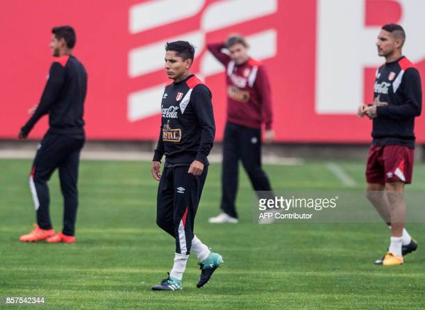 Peruvian footballer Raul Ruidiaz walks on the pitch during a training session in Lima on October 4 2017 ahead of their upcoming 2018 FIFA World Cup...
