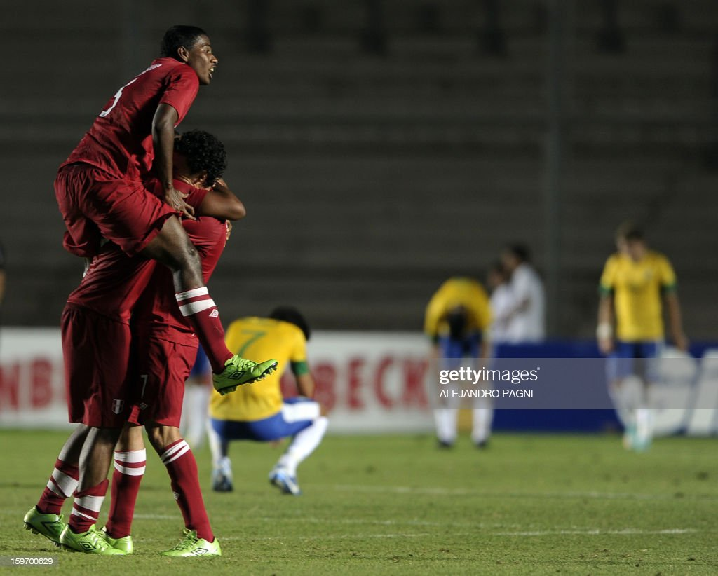 Peruvian footballers celebrate after midfielder Edison Flores (not in picture) scored the team's second goal against Brazil during their South American U-20 Championship Group B football match, at Bicentenario stadium in San Juan, Argentina, on January 18, 2013. Four teams will qualify for the Turkey 2013 FIFA U-20 World Cup.