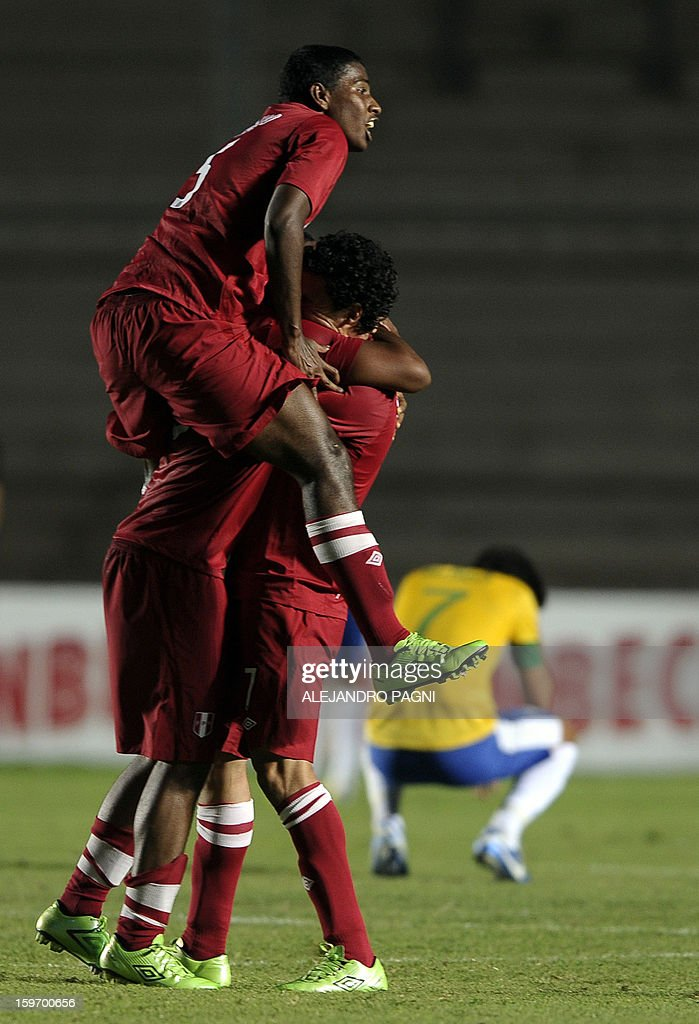 Peruvian footballers celebrate after midfielder Edison Flores (not in picture) scored the team's second goal against Brazil during their South American U-20 Championship Group B football match, at Bicentenario stadium in San Juan, Argentina, on January 18, 2013. Four teams will qualify for the Turkey 2013 FIFA U-20 World Cup. AFP PHOTO / ALEJANDRO PAGNI