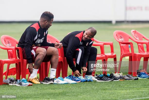 Peruvian footballers Jefferson Farfan and Alberto Rodriguez chat as they get ready for a training session in Lima on October 4 2017 ahead of their...