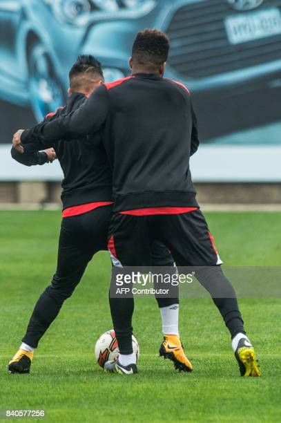 Peruvian footballers Jefferson Farfan and Christian Cueva take part in a training session in Lima on August 29 ahead of their FIFA World Cup...