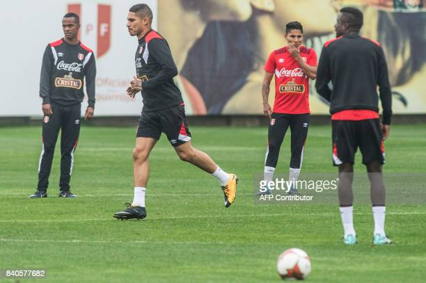 Peruvian footballers Paolo Guerrero Guillermo Carrillo and Raul Ruidiaz take part in a training session in Lima on August 29 ahead of their FIFA...