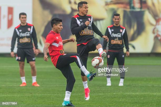 Peruvian footballers Raul Ruidiaz and Yosimar Yotun take part in a training session in Lima on August 29 ahead of their FIFA World Cup qualifier...