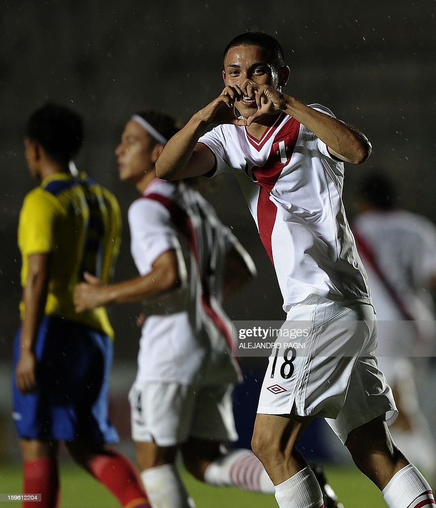 Peruvian forward Jean Deza (R) celebrates after scoring a goal by penalty kick against Ecuador during their South American U-20 Championship Group B football match, at Bicentenario stadium in San Juan, Argentina, on January 16, 2013. Four South American teams will qualify for the FIFA U-20 World Cup Turkey 2013. Ecuador won by 2-1.