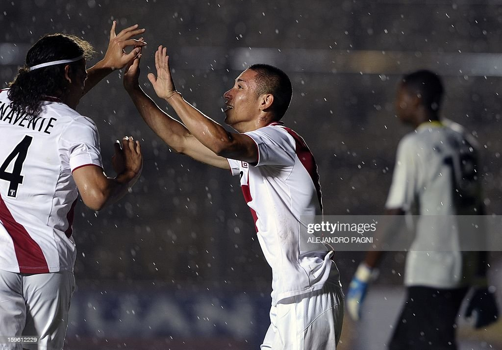 Peruvian forward Jean Deza (C) celebrates with his teammate forward Cristian Benavente (L) after scoring a goal by penalty kick against Ecuador during their South American U-20 Championship Group B football match, at Bicentenario stadium in San Juan, Argentina, on January 16, 2013. Four South American teams will qualify for the FIFA U-20 World Cup Turkey 2013. Ecuador won by 2-1.