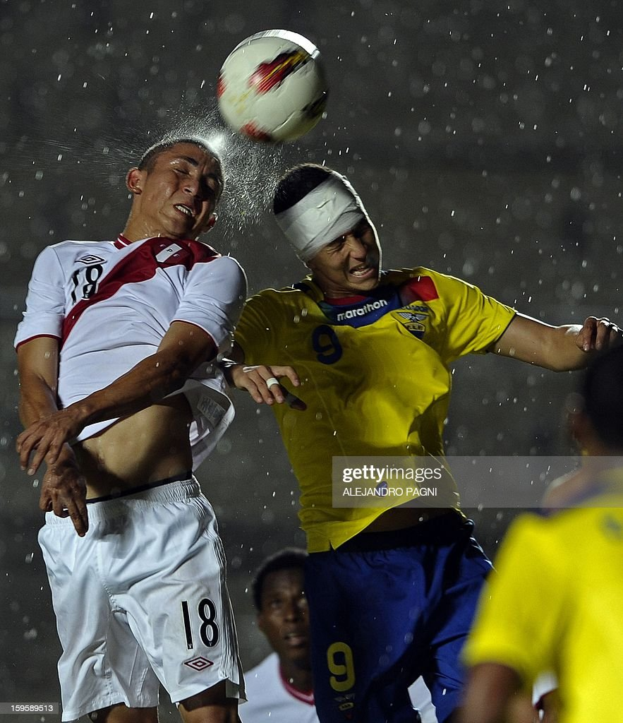 Peruvian forward Jean Deza (L) heads the ball next Ecuadorean forward Miguel Parrales during the South American U-20 Championship Group B football match, at Bicentenario stadium in San Juan, Argentina, on January 16, 2013. Four South American teams will qualify for the FIFA U-20 World Cup Turkey 2013. Ecuador won by 2-1.