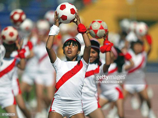 Peruvian girls dance during a performance prior to the start of the Copa America 2004 quarterfinal match between Uruguay Paraguay 18 July 2004 at the...