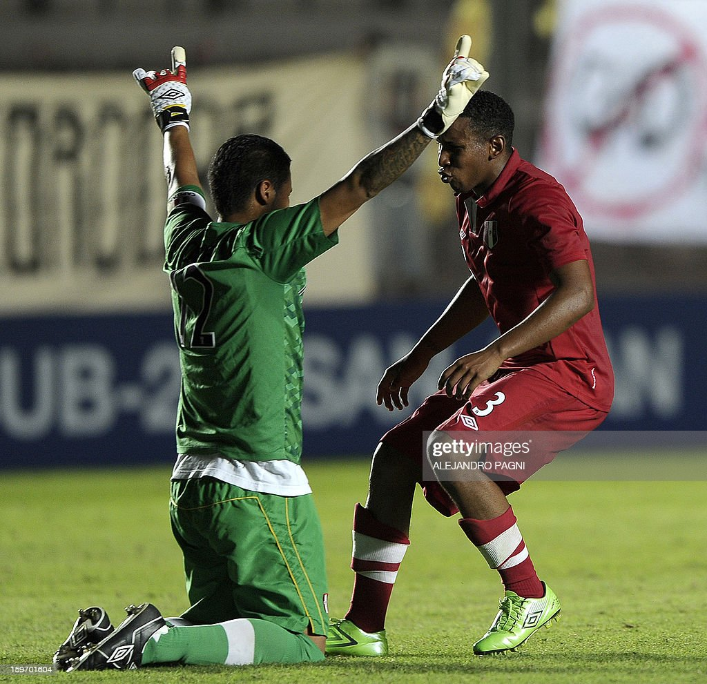 Peruvian goalkeeper Angelo Campos (L) and defender Marcos Ortiz celebrate at the end of their South American U-20 Championship Group B football match against Brazil, at Bicentenario stadium in San Juan, Argentina, on January 18, 2013. Four teams will qualify for the Turkey 2013 FIFA U-20 World Cup.