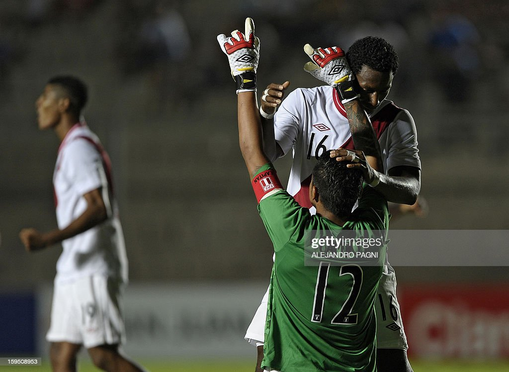 Peruvian goalkeeper Angelo Campos (R-front) celebrates with defender Max Barrios after defeating Venezuela by 1-0 in their South American U-20 Championship Group B qualifier football match, at Bicentenario stadium in San Juan, Argentina, on January 14, 2013. Four South American teams will qualify for the FIFA U-20 World Cup Turkey 2013.