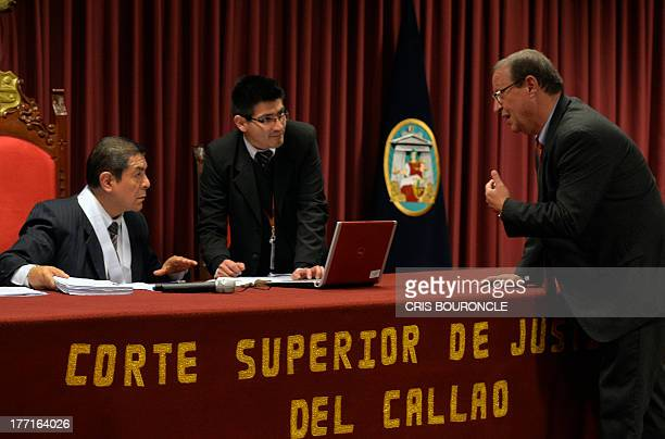 Peruvian judge Dilo Huaman listens to Peruvian lawyer Meyer Fishman who represents Irishwoman Michaella McCollum and Briton Melissa Reid who were...