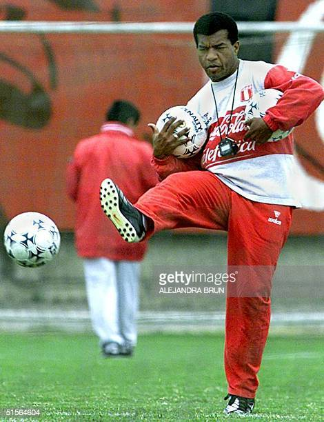 Peruvian Julio Cesar Uribe new tecnical director of the Peruvian selection of soccer kicks balls during training in the National sport villa in Lima...