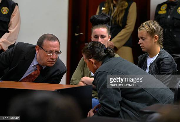 Peruvian lawyer Meyer Fishman who represents British Michaella McCollum and Melisa Reid confers with an unidentified courtappointed translator during...