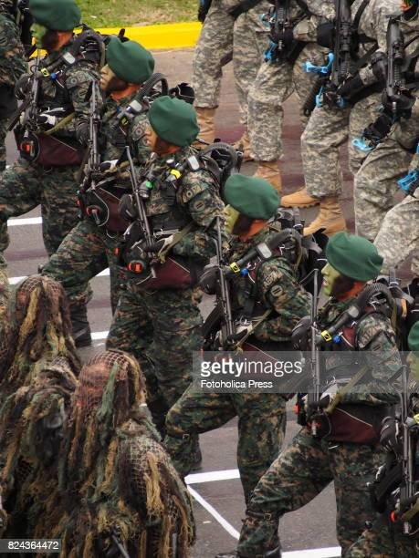 Peruvian marines marching on Military parade commemorating 196th anniversary of Peruvian independence