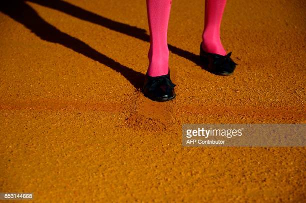 Peruvian matador Andres Roca Rey marks a cross in the ground of the bullring before a bullfight at the Maestranza bullring in Sevilla on September 24...