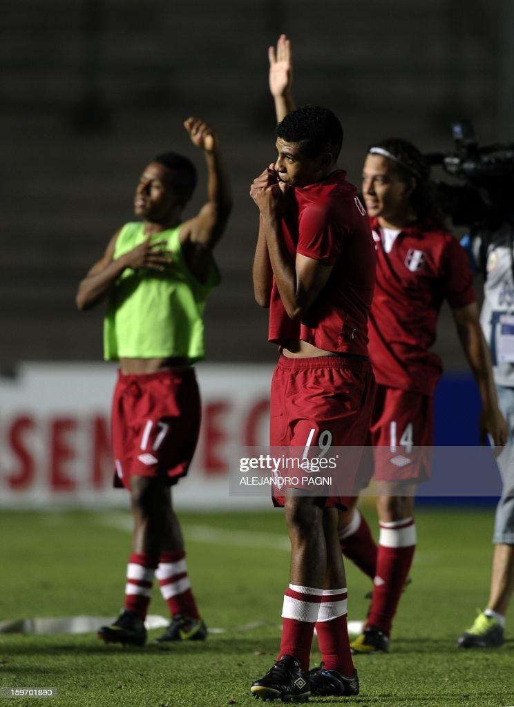 Peruvian midfielder Wilder Cartagena (C), forward Yordi Reina (L) and forward Cristian Benavente celebrate after the victory against Brazil at the end their South American U-20 Championship Group B football match, at Bicentenario stadium in San Juan, Argentina, on January 18, 2013. Four South American teams will qualify for the FIFA U-20 World Cup Turkey 2013. Peru won by 2-0 and advanced for the next round.