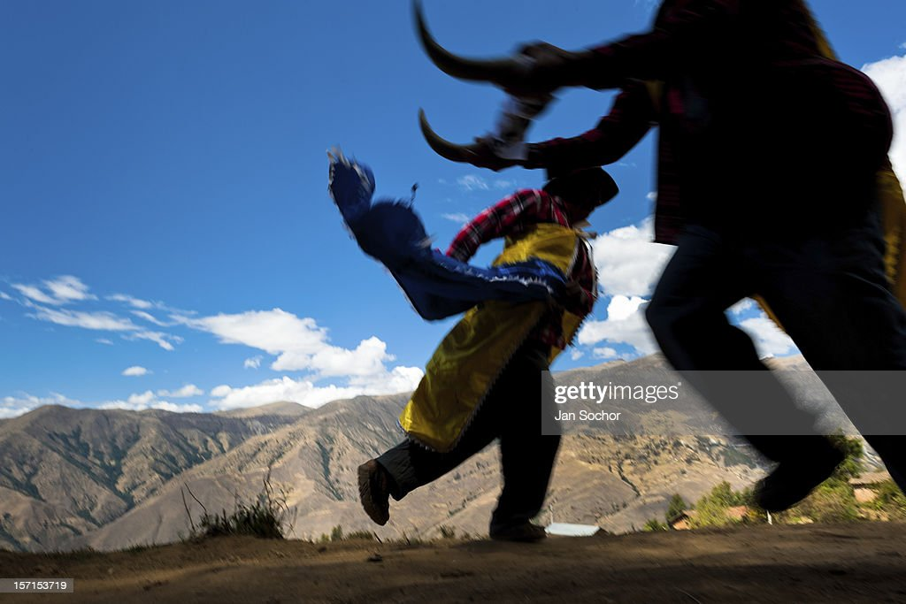 Peruvian peasants perform a fake bullfight during the Yawar Fiesta, a ritual fight between the condor and the bull, held in the mountains of Apurímac on 30 July 2012 in Cotabambas, Peru. The Yawar Fiesta (Feast of Blood), an indigenous tradition which dates back to the time of the conquest, consists basically of an extraordinary bullfight in which three protagonists take part - a wild condor, a wild bull and brave young men of the neighboring communities. The captured condor, a sacred bird venerated by the Indians, is tied in the back of the bull which is carefully selected for its strength and pugnacity. A condor symbolizes the native inhabitants of the Andes, while a bull symbolically represents the Spanish invaders. Young boys, chasing the fighting animals, wish to show their courage in front of the community. However, the Indians usually do not allow the animals to fight for a long time because death or harm of the condor is interpreted as a sign of misfortune to the community.
