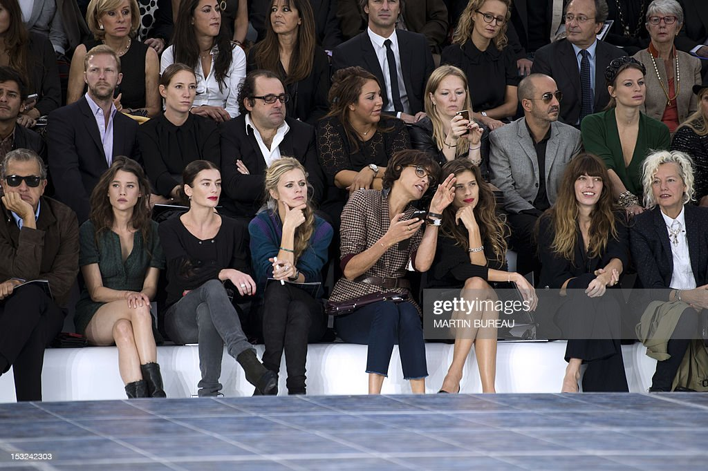 Peruvian photographer Mario Testino, French actress Astrid Berges-Frisbey, French dancer Aurelie Dupont, British model Laura Bailey, former French model and designer Ines de la Fressange, French actress and director Maiwenn, French actress Lou Doillon and German photographer Ellen von Unwerth attend the Chanel Spring/Summer 2013 ready-to-wear collection show on October 2, 2012 at the Grand Palais in Paris.