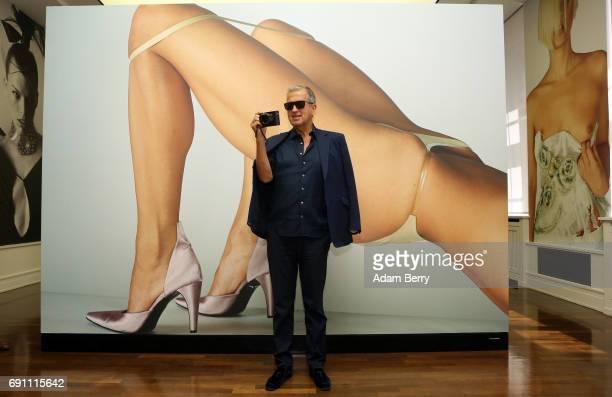 Peruvian Photographer Mario Testino poses in front of his photograph 'Vogue Italia Paris 2000' prior to the opening of the 'Mario Testino Undressed /...