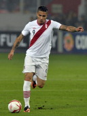 Peruvian player Paolo Guerrero controls the ball during the FIFA Brazil 2014 World Cup South American qualifier match against Uruguay at Limas...