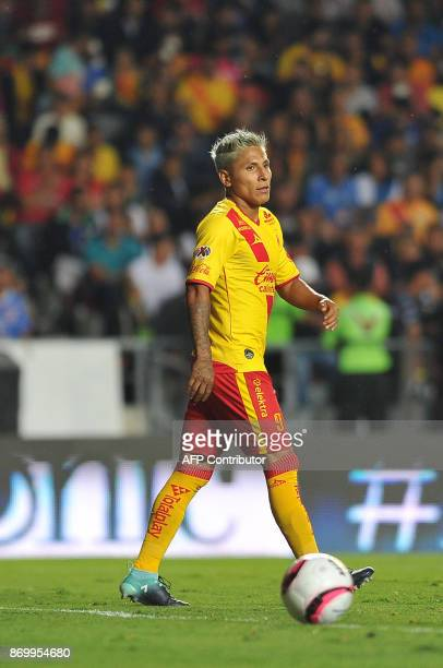 Peruvian player Raul Ruidiaz of Morelia vies for the ball during the match against Cruz Azul during their Mexican Apertura tournament football match...