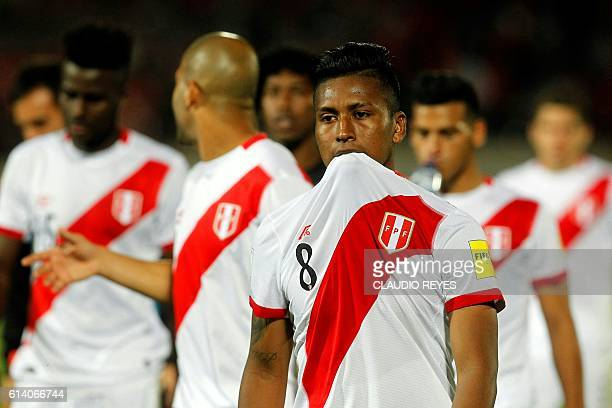 Peruvian players leave the field at the end the Russia 2018 FIFA World Cup qualifier football match against Chile in Santiago on October 11 2016...